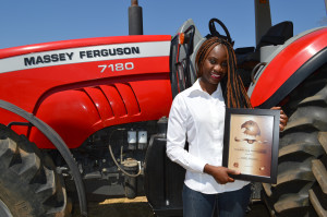 Sue Chuzu, Marketing and Communications Manager, AGCO Zambia receives the Award for long standing Brand