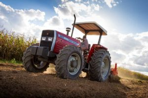 New MF 300 Xtra Series tractors available exclusively through official Massey Ferguson Dealers: The MF 385 Xtra Working with a 7 Tine Cultivator in Zambia, Africa