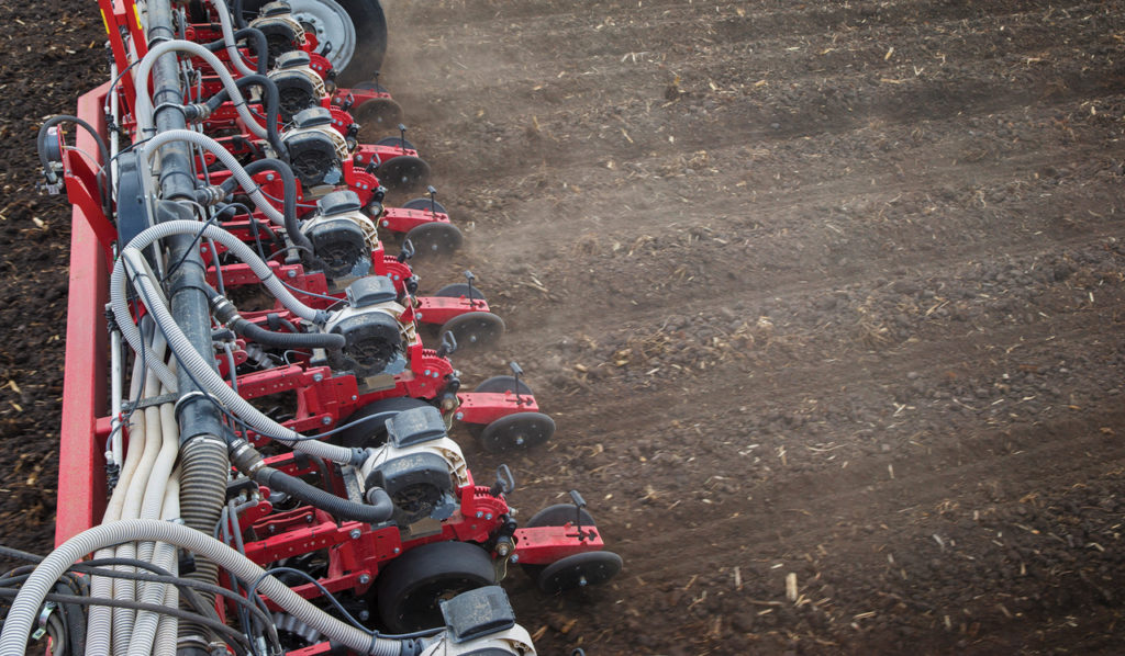 A White Planters 9800VE planting seed accurately at high speeds.