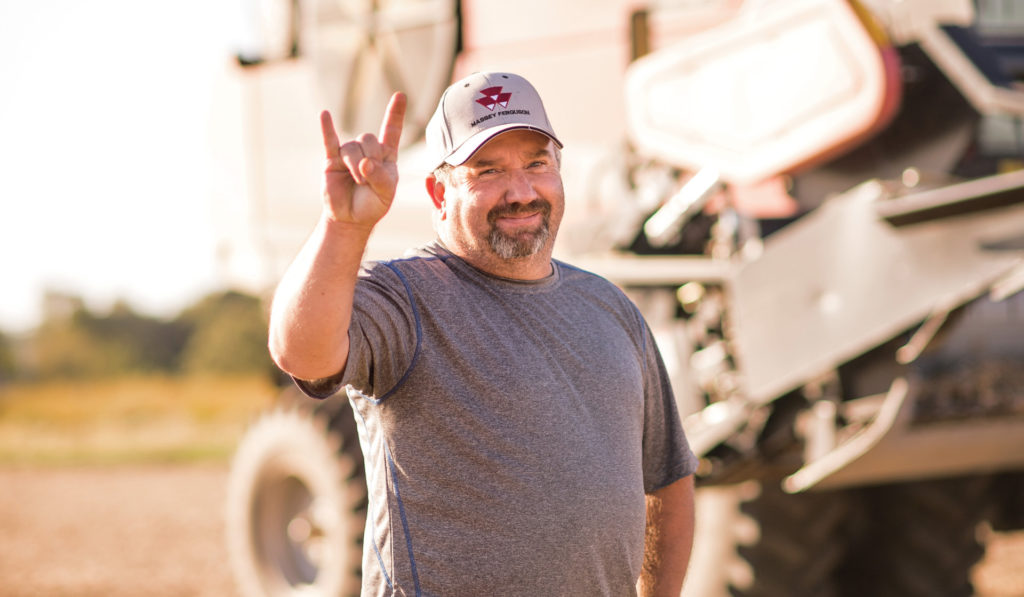 Dave Lynn, A farmer from Illinois stands in front of a high-tech tractor.