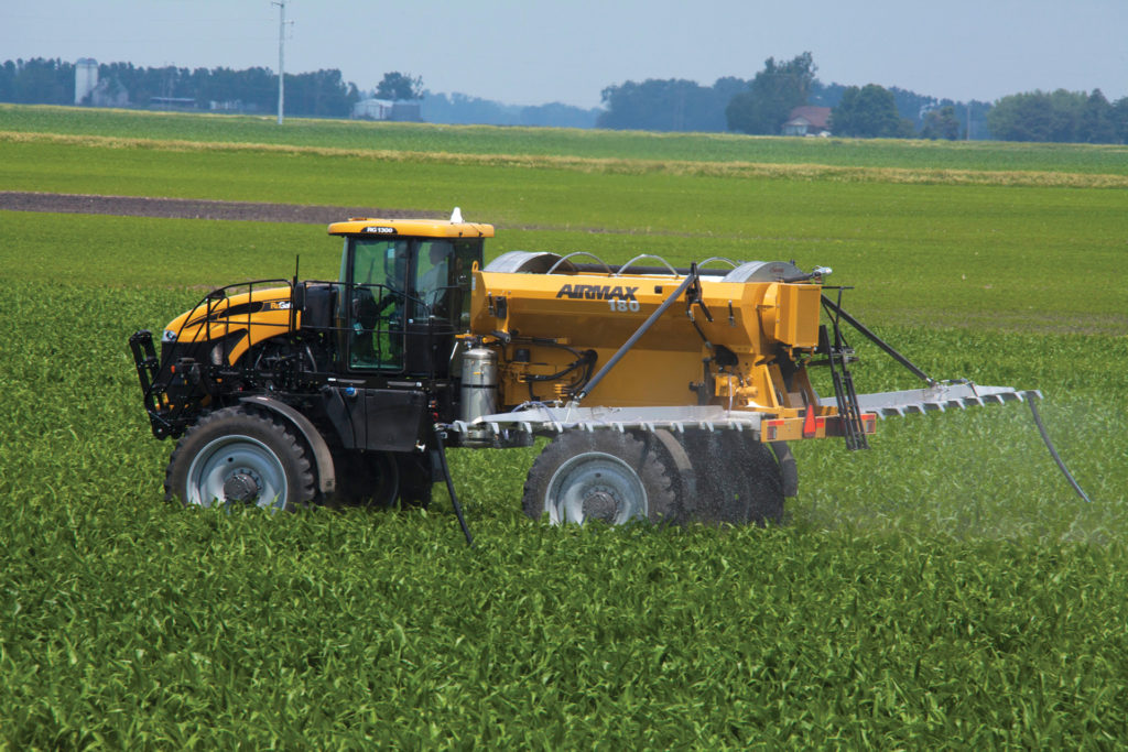 An AirMax 180 pneumatic spreader applying prescribed fertilizer to crops.