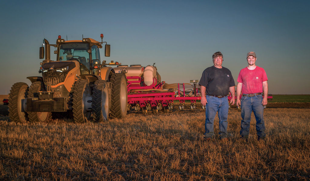 Robin Olson and son, Joseph, with their new Challenger 1042 tractor.