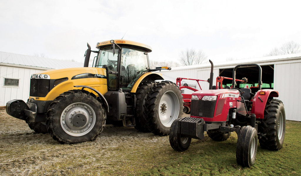 A Challenger MT665C tractor and a Massey Ferguson MF2680 tractor