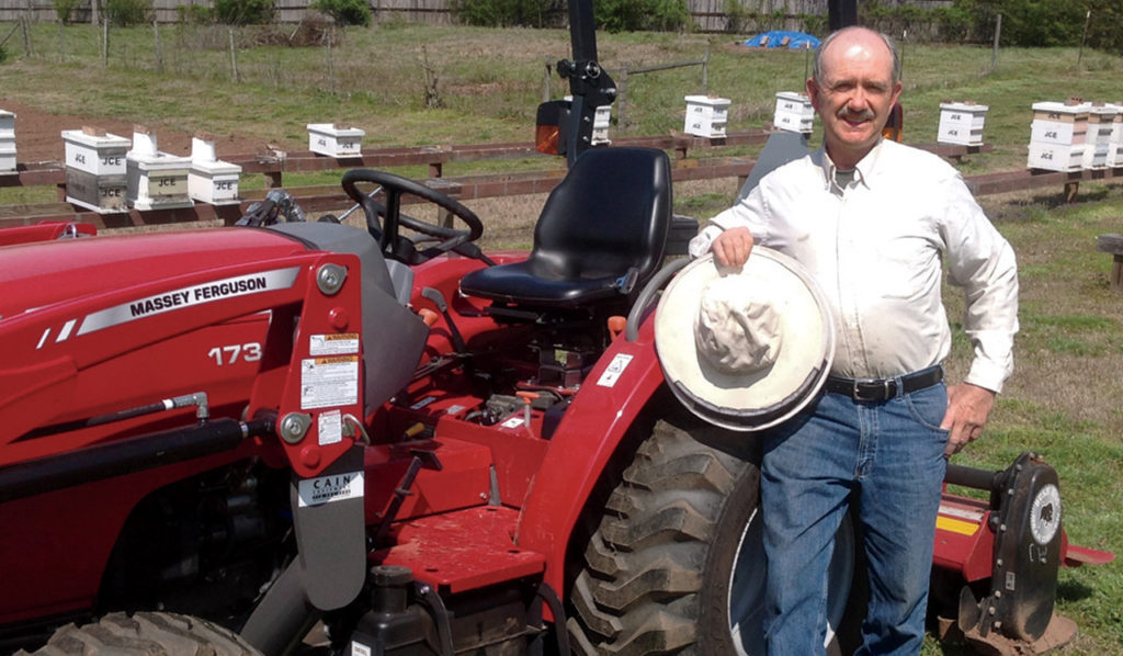 Jim Ellis and his Massey Ferguson 1734E utility tractor.