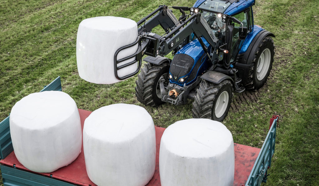White Silage Bales Valtra Tractor