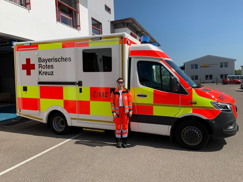 Ambulance with woman in front