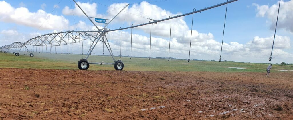 Red soil with moisture, pivot irrigation system